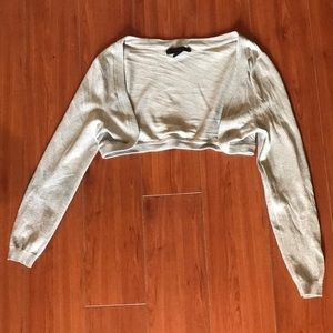 Sparkling silver short waisted long sleeved cover